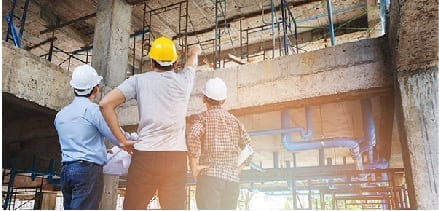 About Us: a team of engineers inspecting a building